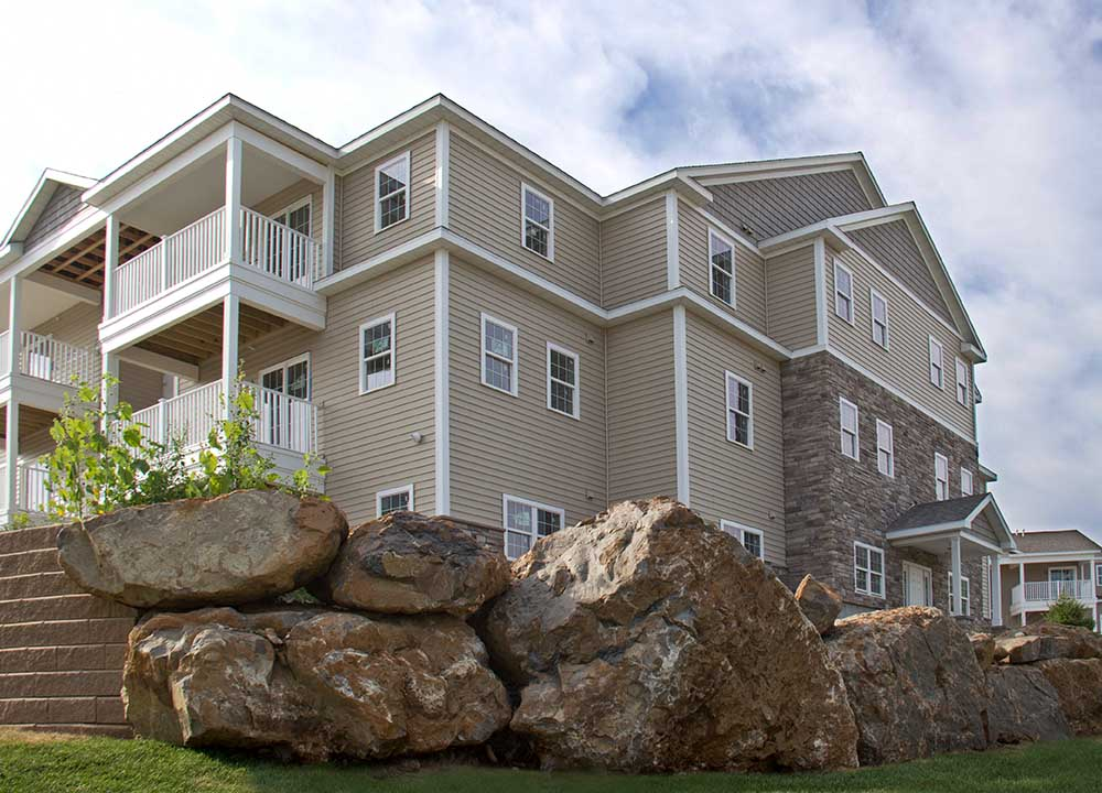 large stone boulders next to apartment building