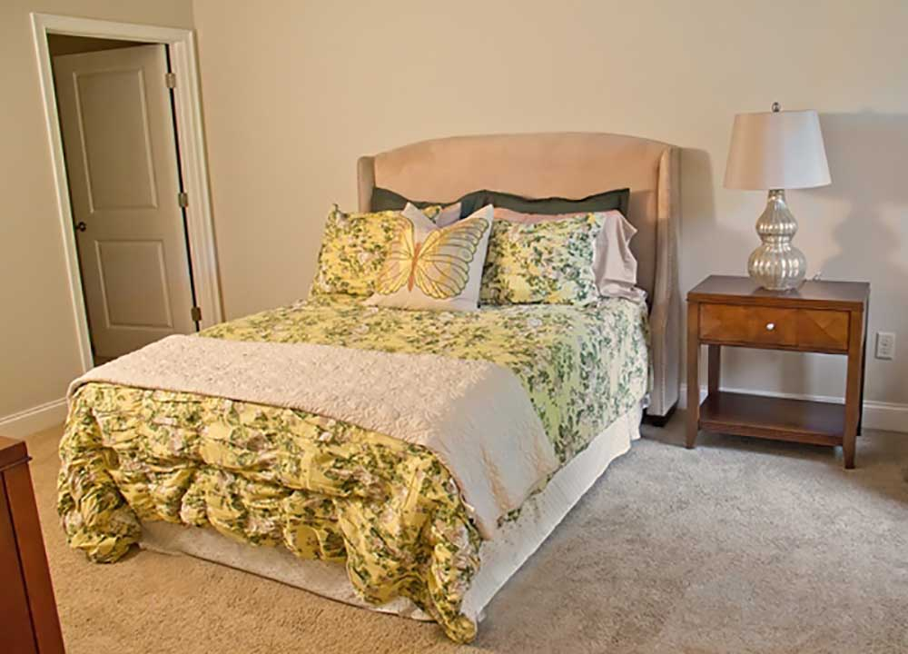 Bed and side table in bedroom