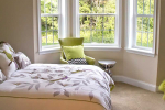 Bedroom with bay window and bed