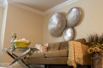 Living room with couch and metal wall art